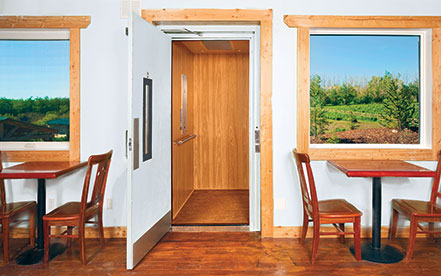 Home Elevator with open swinging hall door
