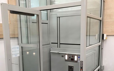 Genesis enclose vertical platform lift with open hall door