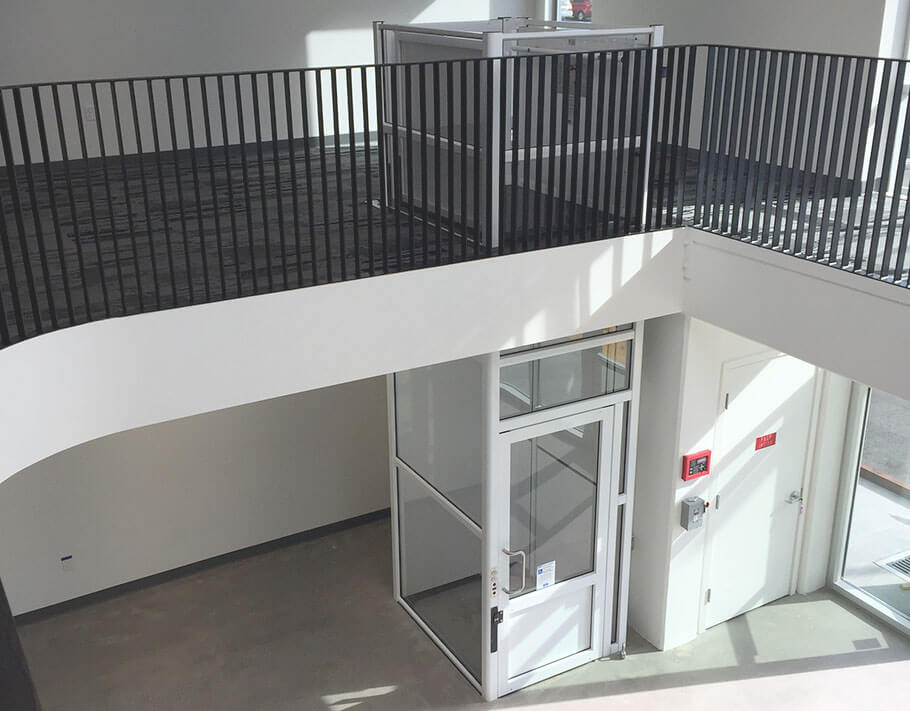 Genesis enclosure model vertical platform wheelchair lift with swinging hall door as seen from the top floo