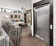 Home elevator with closed 3 speed sliding doors in a modern home