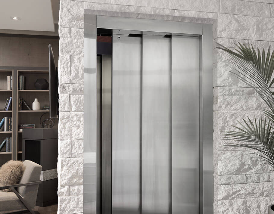 Elvoron home elevator with three speed doors slightly ajar in modern home