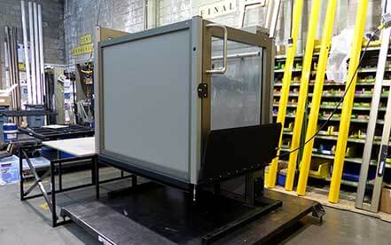 Genesis Staage vertical platform wheelchair lift in production at factory warehouse