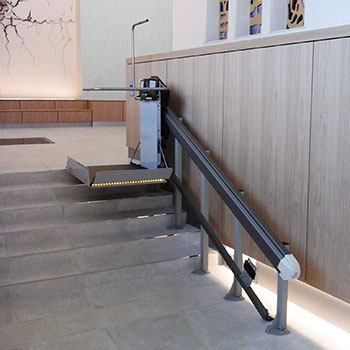 X3 inclined wheelchair lift on a small flight of stairs